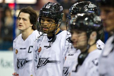 Edmonton defender Jeff Cornwall (second from left) is seen with teammates before the Edmonton Rush took on the Colorado Mammoth during the Rush's season home opener in Edmonton, Alta., on Saturday, Jan. 11, 2014. UFC fighter Georges St. Pierre, who is taking a break from the UFC, attended the lacrosse team's game. Ian Kucerak/Edmonton Sun/QMI Agency