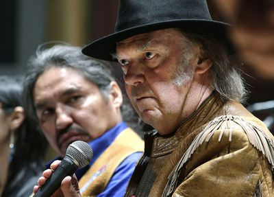 Canadian singer Neil Young (R) and Chief Allan Adams  take part in press conference against the Athabasca tar sands  at Massey Hall on Sunday January 12, 2014. Craig Robertson/QMI Agency