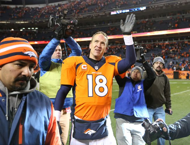 Denver Broncos QB Peyton Manning waves to the crowd after a playoff win on Jan. 12 (Matthew Emmons-USA TODAY Sports)