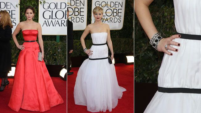 "<B>Star:</b> Jennifer Lawrence   <br><b>Last year:</b> A tomato red strapless Dior gown with a metallic waist-cinching belt and sexy bustier-style top.   <div id=""pd_rating_holder_7384453""></div>