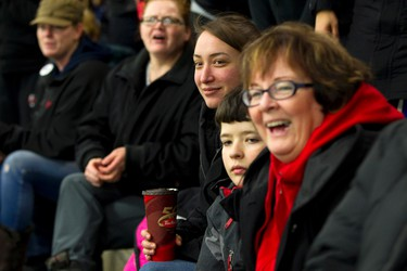 Brave Raiders parents watch the on ice action during their kids' game with the Swat Stars during Quikcard Edmonton Minor Hockey Week play at Russ Barnes Arena in Edmonton, Alta., on Monday, Jan. 13, 2014. Ian Kucerak/Edmonton Sun/QMI Agency