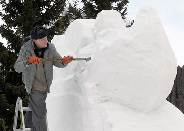 Jacques Boulet works on a snow sculpture of a voyageur and canoe that will be part of the snow bar at the Festival du Voyageur site in Winnipeg, Man. Wednesday Feb. 13, 2013. The annual festival begins Friday and runs for ten days. BRIAN DONOGH/WINNIPEG SUN/QMI AGENCY