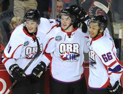 Jared McCann (middle) celebrates the game-winning goal with teammates Brendan Perlini (left) and Josh Ho-Sang as Team Orr beat Team Cherry 4-3 at the 2014 BMO CHL/NHL Top Prospects Game at the Scotiabank Saddledome on Wednesday. Photo by Stuart Dryden/Calgary Sun.