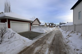 Police investigates some alleys in Terwillegar Towne in Edmonton, AB., on Thursday, Jan 16, 2014.  There has been several reports of assaults on woman in the area.  Perry Mah/Edmonton Sun