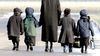 Lev Tahor children are walked home during the lunch hour from the makeshift school they attend in Chatham, Ont., Friday, November 29, 2013. (Diana Martin/QMI Agency)