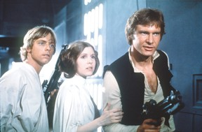 Mark Hamill as Luke Skywalker, Carrie Fisher as Princess Leia and Harrison Ford as Han Solo in Star Wars.
