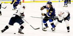 The Saints (white jerseys) and the Oil Barons will be eyeing each other up, and lining each other up, as they meet twice more down the stretch run as the AJHL regular season schedule begins to wind down. - Gord Montgomery, Reporter/Examiner