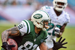 New York Jets tight end Kellen Winslow (81) runs after a catch against the Miami Dolphins during the second half of the game at Sun Life Stadium during the 2013 season. (Brad Barr-USA TODAY Sports)