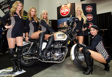 (left to right) AMSOIL spokesmodels Paula, Heather, Karmen, Traci, and Ally pose for a photo with The Motorcycle and ATV Show grand prize, a Triumph Bonneville T100 Motorcycle, at the Edmonton Sun booth at the Edmonton Expo Centre, in Edmonton, Alta., on Friday Jan. 17,  2014. The show runs from Jan 17 - 19. David Bloom/Edmonton Sun/QMI Agency