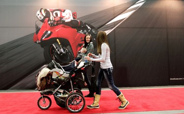 Visitors to The Motorcycle and ATV Show make their way past the Ducati booth at the Edmonton Expo Centre, in Edmonton, Alta., on Friday Jan. 17,  2014. The show runs from Jan 17 - 19. David Bloom/Edmonton Sun/QMI Agency