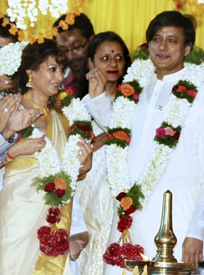 In this photograph taken on August 22, 2010 Indian parliamentarian Shashi Tharoor (R) and his bride Sunanda Pushkar Sunday (L) take part in their wedding ceremony in Pallakad.  The wife of prominent Indian minister Shashi Tharoor was found dead January 17, 2014 in a five-star hotel room after she exposed his alleged adultery with a Pakistani journalist on Twitter, media reports said.  AFP PHOTO/FILES