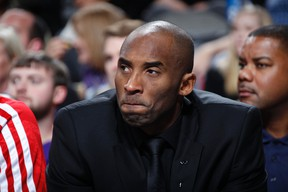 Kobe Bryant of the Los Angeles Lakers watches his team from the bench against the Dallas Mavericks on January 7, 2014 at the American Airlines Center in Dallas, Texas. (AFP)