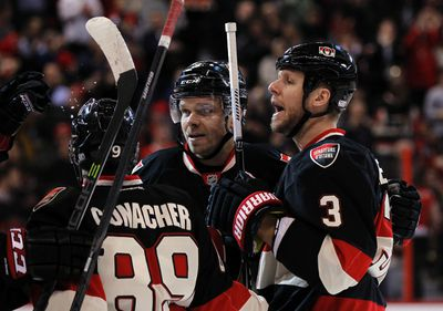 Ottawa Senators' Cory Conacher (89), Milan Michalek (9) celebrate Marc Methot's (3) goal in the first period against the New York Rangers during the first period of NHL action in Ottawa, Ont. on Saturday January 18, 2014. Darren Brown/Ottawa Sun/QMI Agency