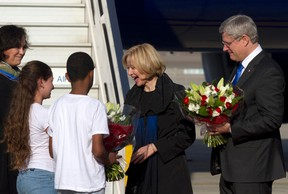 Prime Minister Stephen Harper, right, and his wife Laureen receive flowers from Israeli children after landing at Ben Gurion International Airport near Tel Aviv on January 19, 2014. (REUTERS/Heidi Levine/Pool)
