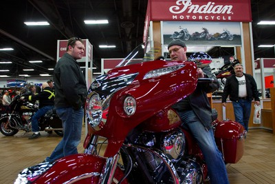 Al (last name withheld), from Spruce Grove, tries out an Indian motorcycle at the Indian Motorcyles during the final day of the Edmonton Motorcycle and ATV Show at the Edmonton Expo Centre in Edmonton, Alta., on Sunday, Jan. 19, 2014. Ian Kucerak/Edmonton Sun/QMI Agency