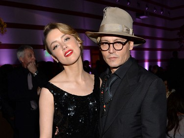 Ring: What looks like a large princess or asscher-cut stone on a platinum band Worn by: Amber Heard  The young actress tried to cover her sparkler while out to dinner with a friend in Los Angeles, but sources say she's engaged to 50-year-old Depp.   (Michael Buckner/Getty Images for Art of Elysium/AFP)