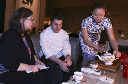 Rita DeMontis, left, interviews award-winning pastry chef Nicholas Patterson at the Shangri-La Hotel in Toronto, during high tea. (VERONICA HENRI/Toronto Sun)