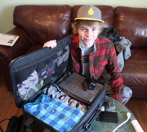 Nat Arney, a Grade 12 student at Ernestown Secondary School, near Kingston, spent Wednesday packing for a trip to Sweden where he will take part in a youth environmental conference.  MICHAEL LEA\THE WHIG STANDARD\QMI AGENCY