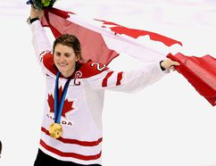 In 2010, Hayley Wickenheiser and her Canadian women's hockey teammates paraded around the ice in Vancouver with the flag and gold medals. In Sochi in February, Wickenheiser will carry Canada's flag at the 2014 Olympic Games Opening Ceremonies. (QMI Agency File Photo)