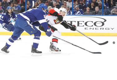 Jan 23, 2014; Tampa, FL, USA; Ottawa Senators left wing Milan Michalek (9) shoots the puck as Tampa Bay Lightning defenseman Eric Brewer (2) defends during the first period at Tampa Bay Times Forum. Mandatory Credit: Kim Klement-USA TODAY Sports