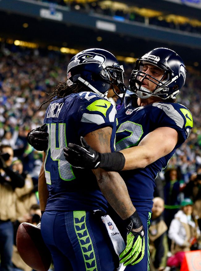 Seattle Seahawks running back Marshawn Lynch (left) celebrates a touchdown against the San Francisco 49ers with tight end Luke Willson during the NFC championship game at CenturyLink Field in Seattle, Jan. 19, 2014. (JONATHAN FERREY/Getty Images/AFP)