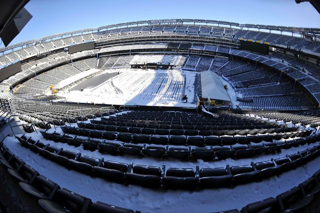 A general view as stadium workers clean snow from the field and stands during the Super Bowl XLVIII stadium preparations press conference at MetLife Stadium, Jan 22, 2014; East Rutherford, NJ, US. (Photo Joe Camporeale-USA TODAY Sports)