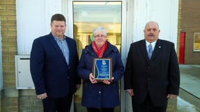 Lambton County Warden Todd Case, left, presents his Citizen of the Month award to Oil Springs resident Cathy Martin. They are joined by Oil Springs Mayor Ian Veen. SUBMITTED PHOTO