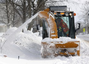 Angela Hughes is part of the Town of Tillsonburg's snow-clearing team, operating here on the sidewalk along Rolph Street. Staff has been extremely busy says Director of Operations Steve Lund, reacting to an estimated two-foot dump since Thursday. Jeff Tribe/Tillsonburg News