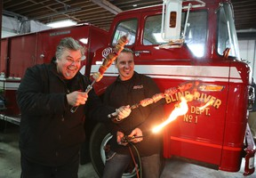 Celebrity Chef Ted Reader, left, with George Tchor of Kreater in front of a 1973 vintage Ford fire truck which is being transformed into a one-of-a-kind BBQ rig.