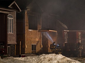 Fire crews respond to the scene of a house fire near 154 Street and 98 Avenue on Tuesday. (Codie McLachlan/Edmonton Sun)