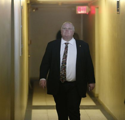 Mayor Rob Ford spent a couple of hours touring 5 Lynvalley Cres., a privately run six-storey apartment building where he says he found many violations of municipal standards on Tuesday. (MICHAEL PEAKE/Toronto Sun)
