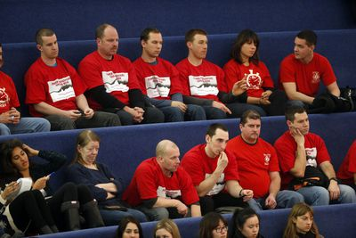 Toronto firefighters, wearing red shirts, were at City Hall on Wednesday to fight budget cuts. (MICHAEL PEAKE/Toronto Sun)