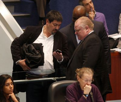 Angelo Carnevale, left, a candidate for the next municipal election in Ward 4  talks with Mayor Rob Ford at City Hall on Wednesday. (MICHAEL PEAKE/Toronto Sun)