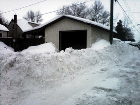 In 2014, East Kildonan resident Matt Sheppard came home Tuesday to a 3 1/2-foot tall windrow. (HANDOUT)