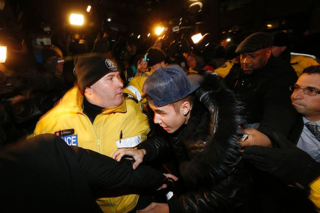 Pop singer Justin Bieber arrives at a police station in Toronto January 29, 2014. (REUTERS/Alex Urosevic)
