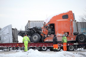 Crews remove one of the transports damaged in Thursday multi-vehicle crash on Hwy. 401 near Napanee.