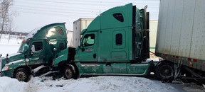 A pair of transport trucks caught up in Wednesday's massive crash on Hwy. 401 near Napanee.