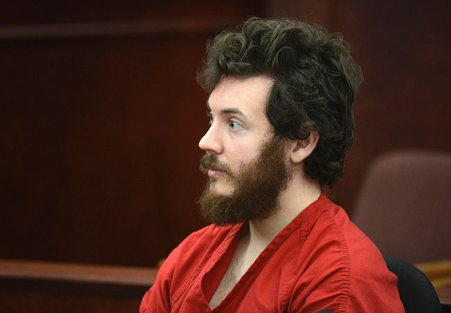 Accused Aurora theater shooting suspect James Holmes listens at his arraignment in Centennial, Colorado in this file photo taken March 12, 2013. (REUTERS/R.J. Sangosti/Pool)