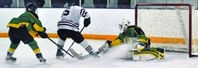 Hawk Ben Hartung drives to the net last Thursday during a provincial playdown game against Okotoks at the Vulcan District Arena. Stephen Tipper Vulcan Advocate
