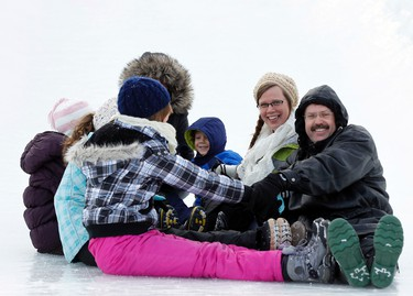 The Vogel family from Wyoming, ON, enjoy the ice slides during the opening day of Winterlude at Jacques Cartier Park in Gatineau, QC on Friday January 31, 2014.Darren Brown/Ottawa Sun/QMI Agency
