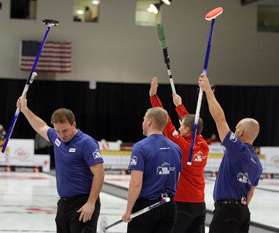 Team Jeff Stoughton wave to the crowd after defeating Mike McEwen 8-3 in the Safeway Select men's curling final in Winnipeg, Man. Sunday February 02, 2014. Brian Donogh/Winnipeg Sun/QMI Agency
