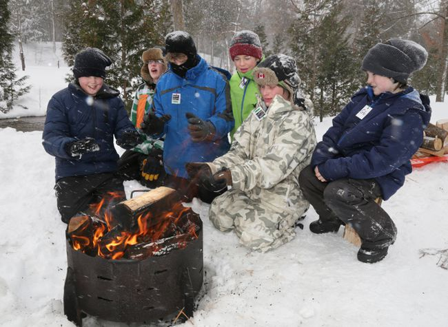 "If you're an adventurous traveller who has always wanted to try camping outdoors in winter, <a href=""http://www.scouts.ca"">Scouts Canada</a> has listed their top 10 tips for making your winter camping experience a positive one. These young outdoor experts know the best way to ensure a fun, safe outdoor winter camping trip is preparation. Find Scouts Canada's top 10 tips for winter camping in our gallery. Text courtesy Scouts Canada.<br><br><i>Pictured: Members of the 1st Gravenhurst Scouts warm their hands and dry their gloves in front of a fire during the 51st Annual Winter Campout at Harrison Park, Ont. on January 25, 2014.</i> (JAMES MASTERS/QMI Agency)"