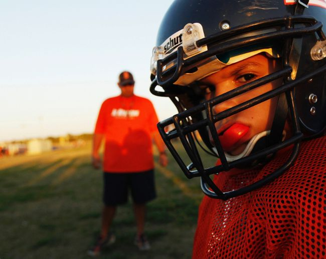 A youngster chews on his mouthguard during the filming of the television docu-series 'Friday Night Tykes' in this undated handout picture from the Esquire Network taken in San Antonio, Texas. (REUTERS/Walter Iooss/Esquire Network/Handout)
