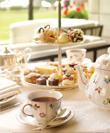 A three-tiered tea tray laden with savoury and sweet treats at the Biltmore Phoenix, where a traditional English tea is served in the hotel lobby. NICOLE HANN PHOTO
