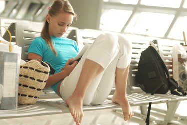 GETTING THERE: 6. Confirm your flight before heading to the airport to ensure it's on schedule, suggests RBC Insurance's Forget. In case of delays, plan activities or bring books to keep yourself and family occupied. (Fotolia)