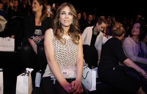 Actress and model Liz Hurley arrives to watch the show by Marc Cain at the Berlin Fashion Week Autumn/Winter 2014 in Berlin January 16, 2014. REUTERS/Tobias Schwarz