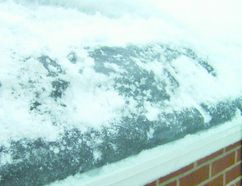 Ice damming on the lower edge of the roof or gutters of a house can cause moisture to back up into the shingles, the attic or the house itself. (Special to the Free Press)