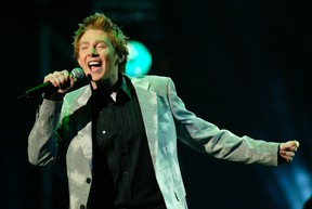 """Singer Clay Aiken, an """"American Idol"""" finalist performs onstage at the 31st annual American Music Awards in Los Angeles, California in this November 16, 2003 file photo. (REUTERS/Jim Ruymen/Files)"""