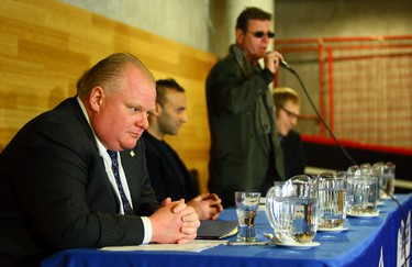 Mayor Rob Ford listens to fellow mayoral candidate Al Gore during the mayoral debate at University of Toronto Scarborough Campus in Toronto on Wednesday February 5, 2014. (Dave Abel/Toronto Sun)