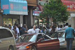 Astramed Physicians clinic's Dr. Robert Terdiman (white shirt, pointing) is pictured in front of the Astramed Physicians clinic in New York, in this July 9, 2013 handout surveillance photo provided by the Office of the Special Narcotics Prosecutor for the City of New York. Terdiman is one of 25 people who were charged with involvement in a massive scheme that flooded New York City's black market with as much as $500 million in painkillers, federal and state officials said on February 5, 2014.    REUTERS/Office of the Special Narcotics Prosecutor for the City of New York/Handout